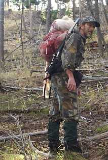 Packing elk meat on a backpack