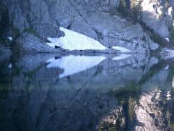 Mountain lake with snowy ledge
